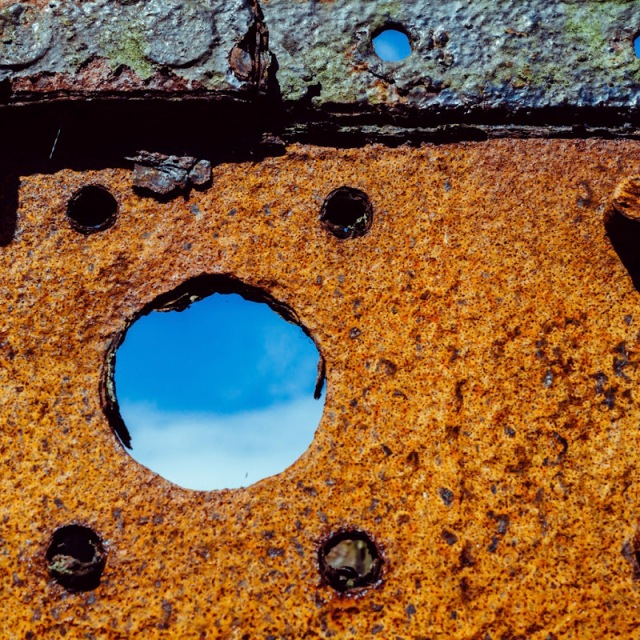rusty metal framing the sky